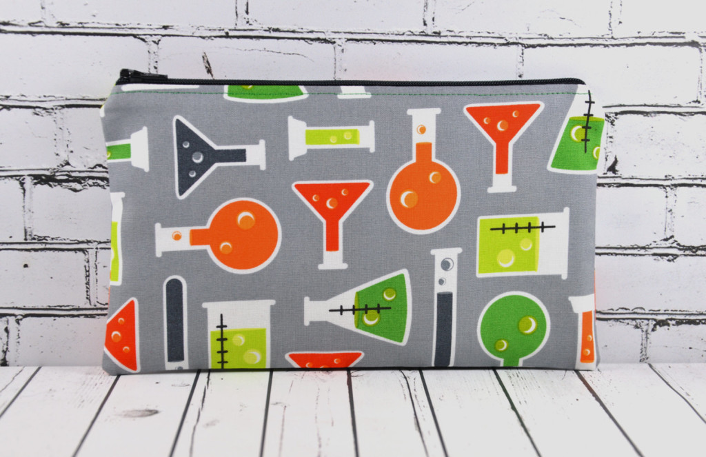 pencil case made of fabric printed with beakers and test tubes